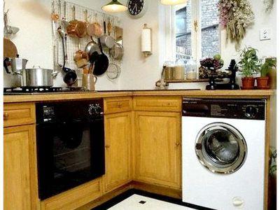 Как выбрать модель стиральной машины, чтобы встроить ее на кухню: преимущества и недостатки конструкций